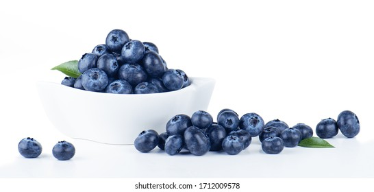 Blueberries in white bowl on white background