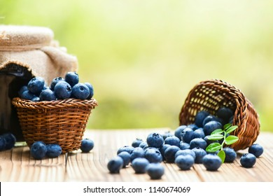 Blueberries in wicker basket and blueberry jam or marmalade