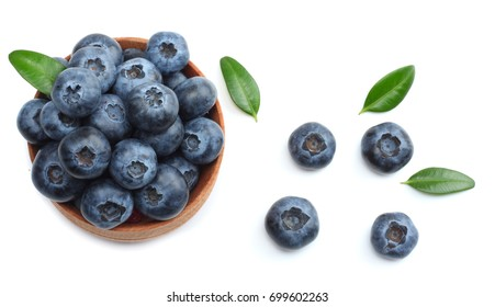 blueberries in wooden bowl isolated on white background