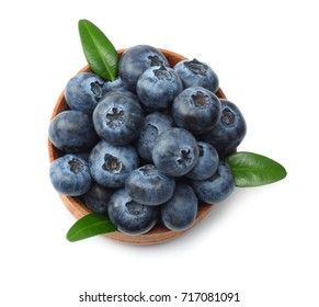 blueberries in wooden bowl isolated on white background. top view