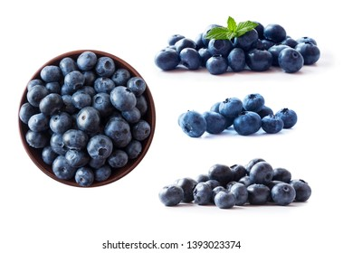 Blueberries in a wooden bowl. Ripe blueberries with copy space for text. Blueberry isolated on white. Bilberries  on a white background. Top view. Blueberries on a white background. Blue food.
