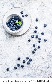 Blueberry antioxidant organic superfood. Fresh Blueberries on blue background. Juicy wild forest berries, bilberries. Healthy eating or nutrition. Top view. Copy space.