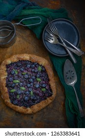 Blueberry basil gallette on a dark background