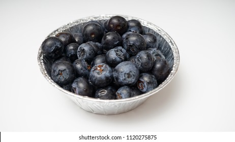 Blueberry in a bowl isolated on white background
