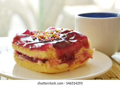 blueberry butter cake topping colorful candy and coffee cup