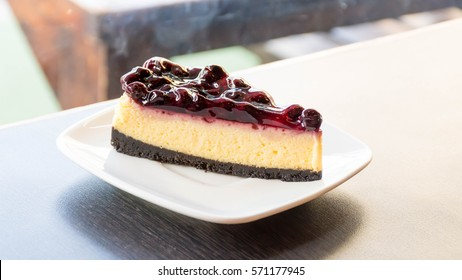 blueberry cheese cake on the table in cafe