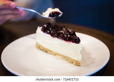 Blueberry cheese cake on white plate