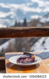 blueberry cheese cake outdoors in the mountains