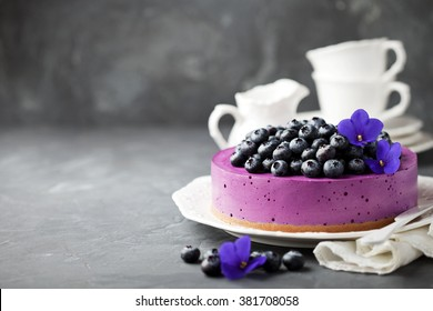 Blueberry cheesecake with fresh blueberries, selective focus