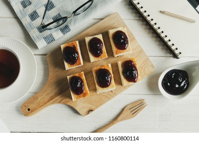 Blueberry Cheeze Cake on wood plate.