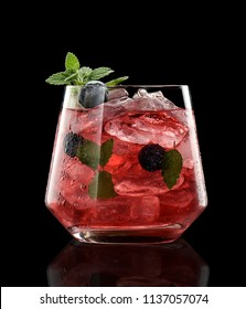 blueberry cocktail isolated on a black background decorated with mint