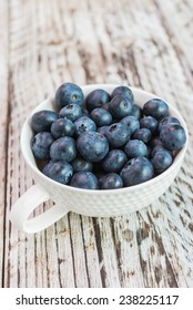 blueberry cup on wooden background