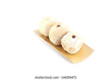 The Blueberry donuts in bamboo dish on white background.