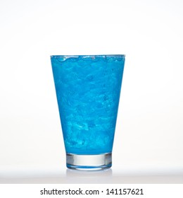Blueberry flavor aerated soft drinks whit ice in glass isolated on white background