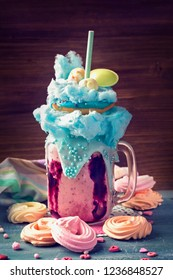 Blueberry freakshake with donuts and candy floss