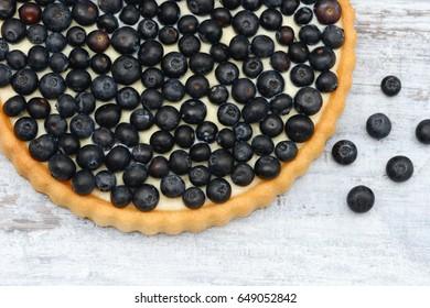 blueberry fruit cake on wood