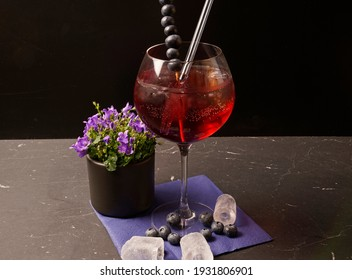 Blueberry gin date in water. tasty and fruity cocktails served in glasses
