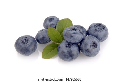 blueberry and green leaves are on white background