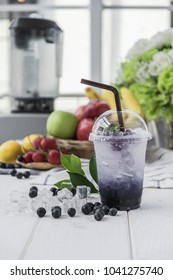 blueberry italian soda arranged on wood table,