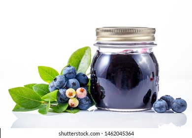 Blueberry jam with berries on white