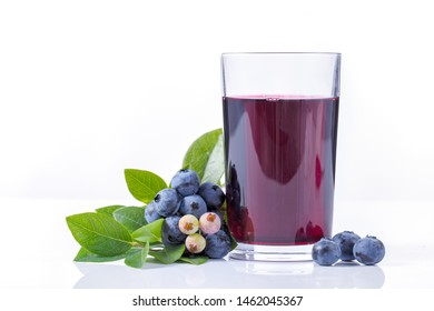 Blueberry juice and fruit on white background