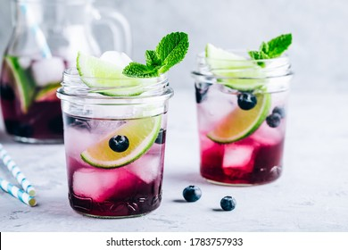 Blueberry and lime mojito or lemonade. Refreshing summer drink with berry and ice.