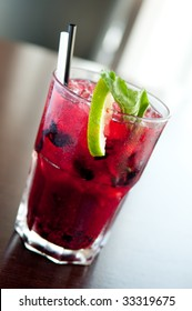 blueberry mojito cocktail with mint and lime