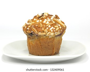 blueberry muffin with almond toppings on plate