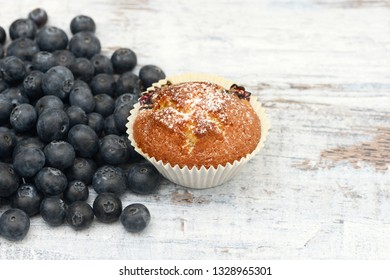 Blueberry Muffin and blueberries on wood