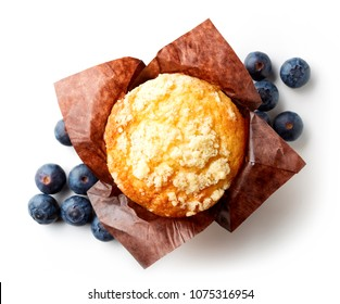 Blueberry muffin in brown paper isolated on white background, top view