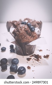 Blueberry muffin with chocolate on white background