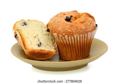 blueberry muffin on plate isolated on white