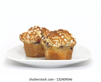 blueberry muffins with almond toppings on plate