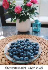Blueberry on a glass table. Blueberries in a beautiful bowl. Closeup. Blueberry season