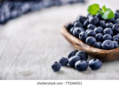 Blueberry on white wooden table. Blueberries in wooden bowl, Blue berry detail