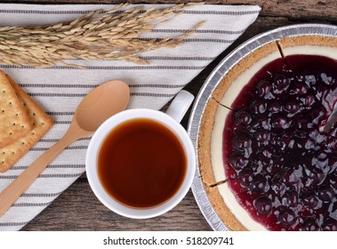 Blueberry pie and berries on rustic wooden table