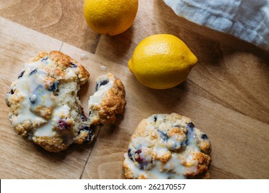 Blueberry Scones with Lemon Glaze on a Wood Background