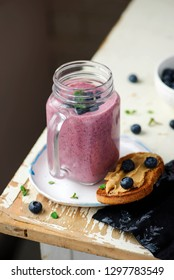 Blueberry smoothie.and peanut butter toast.selective focus