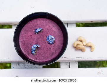 blueberry smoothie, summer breakfeast on a white table