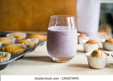 Blueberry smoothies with banana muffins, concept for healthy breakfast and snack.