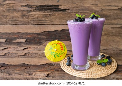 blueberry smoothies juice purple,beverage healthy the taste yummy In glass,drink episode morning on wooden background.