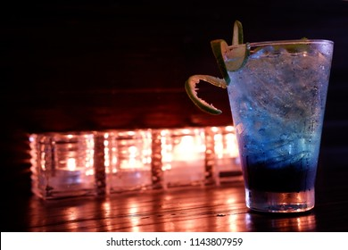 blueberry soda on wooden background and candle
