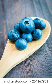 Blueberry spoon on wooden background - vintage effect style pictures