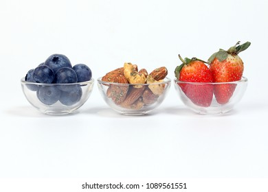 Blueberry Strawberry Herb Spice Almond Cashew Nut in glass bowl on white background