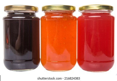 Blueberry, strawberry and orange fruit bottled jam over white background