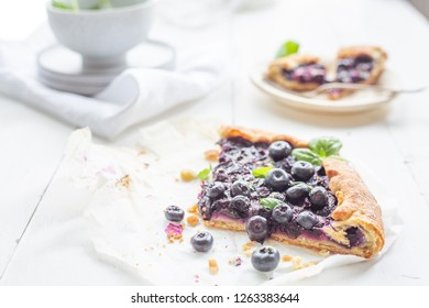 Blueberry tart on  a white background