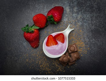Blueberry yoghurt with some strawberries combined with milk chocolate.