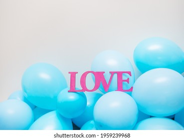 Blue-blue balloons, birthday. Greeting card, wooden pink letters love