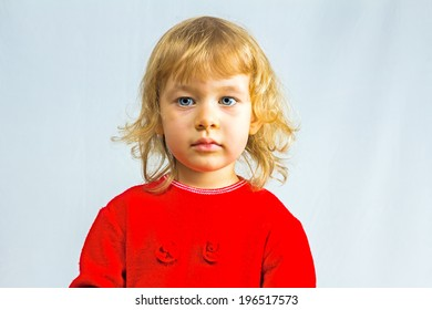 Blue-eyed, 3 year old girl in red dress
