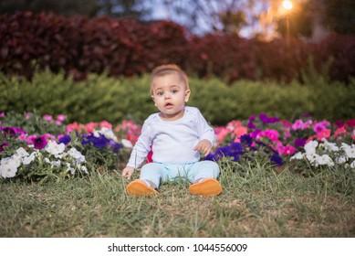 Blue-eyed baby in the garden